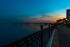Spring night city Saratov quay under sunset. Street decorative lights and beautiful sky. Aerial stock image