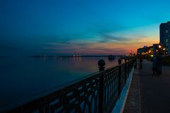 Spring night city Saratov quay under sunset. Street decorative lights and beautiful sky. Aerial stock photography