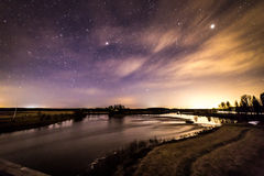 Spring night at the river. Beautiful spring night and starlit sky by the river. Fascinating colors appeared in the sky Royalty Free Stock Image
