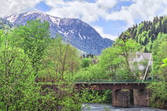 Spring North Caucasus landscape with mountain river and bridge Stock Image