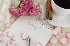Spring notebook, cup of coffee, roses cinnamon spring royalty free stock image