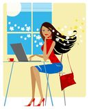 Spring at the office. Young lady working on laptop at office or internet cafe Royalty Free Stock Image