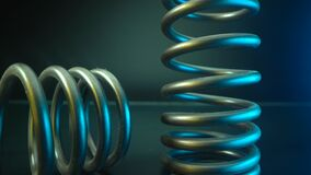 Spring. One of the car`s part for stability and comfort driving. Beautiful blue and yellow light. Car parts in macro