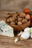 Spring onion and danish blue cheese in front of walnuts Royalty Free Stock Image