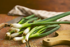 Spring onion on old wooden table Royalty Free Stock Photography