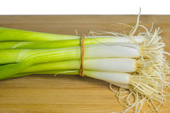 Spring onion on a plank Stock Images