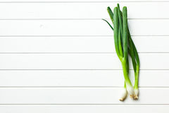 Spring onion on white table Royalty Free Stock Images
