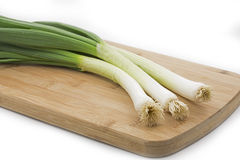 Spring onions on a board Royalty Free Stock Photo