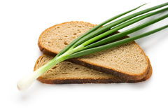 Spring onions and bread Stock Image