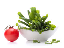 Spring onions and cherry tomato in bowl Stock Photography