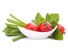 Spring onions and cherry tomato in bowl Stock Images