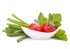 Spring onions and cherry tomato in bowl Stock Photo