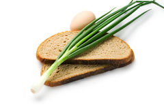 Spring onions, egg and bread Royalty Free Stock Photography