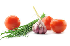 Spring onions, garlic and tomato Stock Images