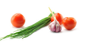 Spring onions, garlic and tomato Royalty Free Stock Images