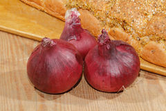 Spring onions, onions, vegetables, wooden board. Spring onions, onions, vegetables on a wooden chopping board Royalty Free Stock Image