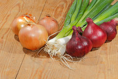 Spring onions, onions, vegetables. On a wooden chopping board Stock Image