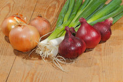 Spring onions, onions, vegetables. On a wooden chopping board Royalty Free Stock Photo