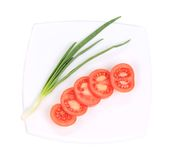 Spring onions and sliced tomatoes. Stock Images