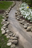 Spring outdoor landscapes design with flowing water. Crooked path ,it is in Dallas arboretum Royalty Free Stock Photos