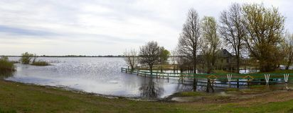 Spring panorama with the river in flood cloudy day Royalty Free Stock Images