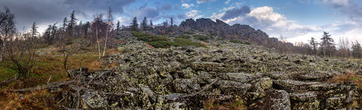 Spring panorama of a rocky ridge with stone talus Stock Photography