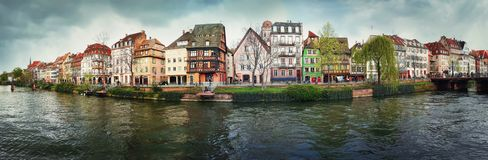 Spring panorama of Strasbourg city in front of Quai des Bateliers street along water canal. Fachwerk timber framing colorful. Houses. Traditional architecture royalty free stock photo