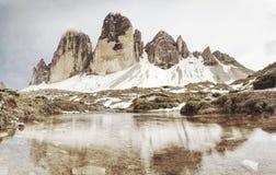 Spring panorama view to Three peaks - Tre Cime di Lavaredo massive rock stock photography