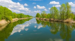 Spring panoramic landscape with small river Stock Images