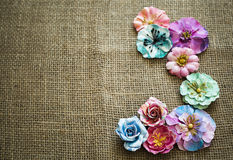 Spring paper flowers on sack texture Royalty Free Stock Photo