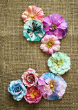 Spring paper flowers on sack texture Stock Photo
