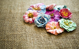Spring paper flowers on sack texture Royalty Free Stock Photography
