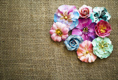 Spring paper flowers on sack texture Stock Photography