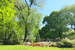 Spring park with blossoming flowerbeds Stock Photo