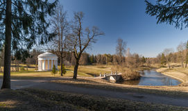Spring park with classical building and bridge Stock Images