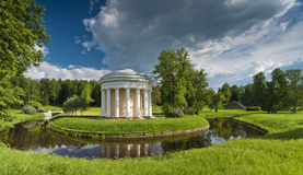 Spring park with classical building and bridge royalty free stock photo