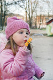 Spring in the park little girl blowing soap bubbles Royalty Free Stock Images
