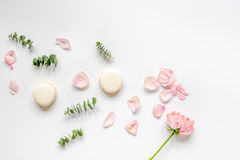 Spring pattern with macaroons and flower in soft light top view Stock Photo