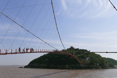 In spring, people walk on cable-stayed bridge to the island, to take wedding photographs Royalty Free Stock Image