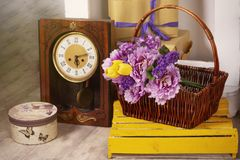 Spring photo with retro clock flowers in a basket box royalty free stock photos
