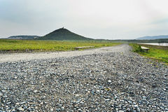 Spring photo of stones on the road leading under the castle Hnevin and around the lake Most in czech landscape during windy weathe Royalty Free Stock Images