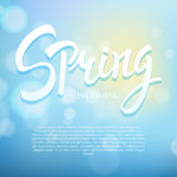 Spring phrase vector lettering. Hand drawn calligraphy blue background. Royalty Free Stock Photography