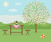 Spring picnic in garden. Resting in a sunny day. Stock Photography