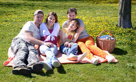 Spring picnic for whole family. Happy family spend time together in spring park Royalty Free Stock Image