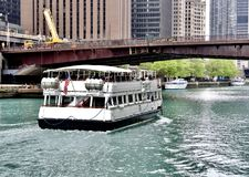 Chicago River Tour Boat. This is a Spring picture of a Chicago River Tour Boat heading West and about to go under the iconic Columbus Drive Bridge On The Chicago stock images
