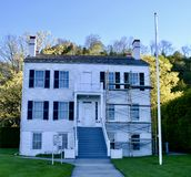 Indian Dormitory. This is an early morning Spring picture of the historic Indian Dormitory located on Mackinac Island, Michigan.  This three-story framed stock photos