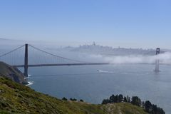 For Moving Through Golden Gate Bridge. This is a Spring picture of fog moving through the Iconic Golden Gate Bridge Over San Francisco Bay located in San Royalty Free Stock Photos