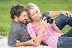 Spring at the pictures. Loving young couple is looking at the ph Stock Image