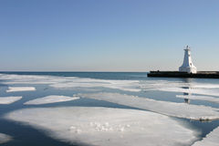Spring at the pier. Sheets of ice melt in the harbour Stock Photos