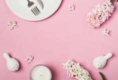 Spring Pink flat lay. White Table setting and hyacinths flowers.  Stock Photo